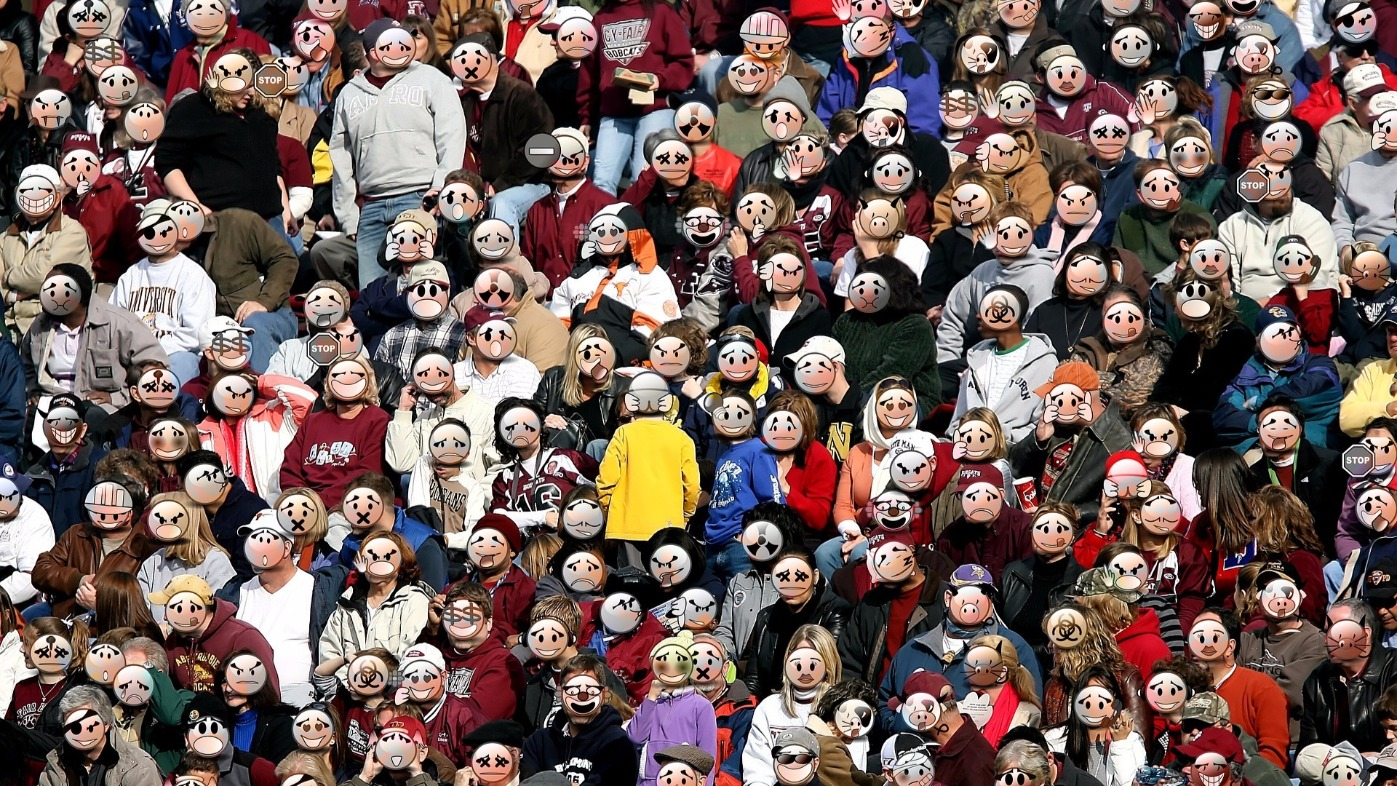 A crowd of people whose faces have been replaced by emoticons, including happy, sad, angry, pirate, and crying faces.