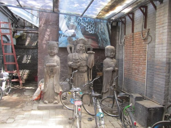 These statues were in a side alley people park their bikes in. Does this work matter?